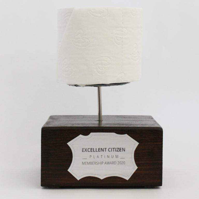 Toiletpaper Award Kim Okura Excellent Citizen Award Toiletpaper Roll on Wood Panel