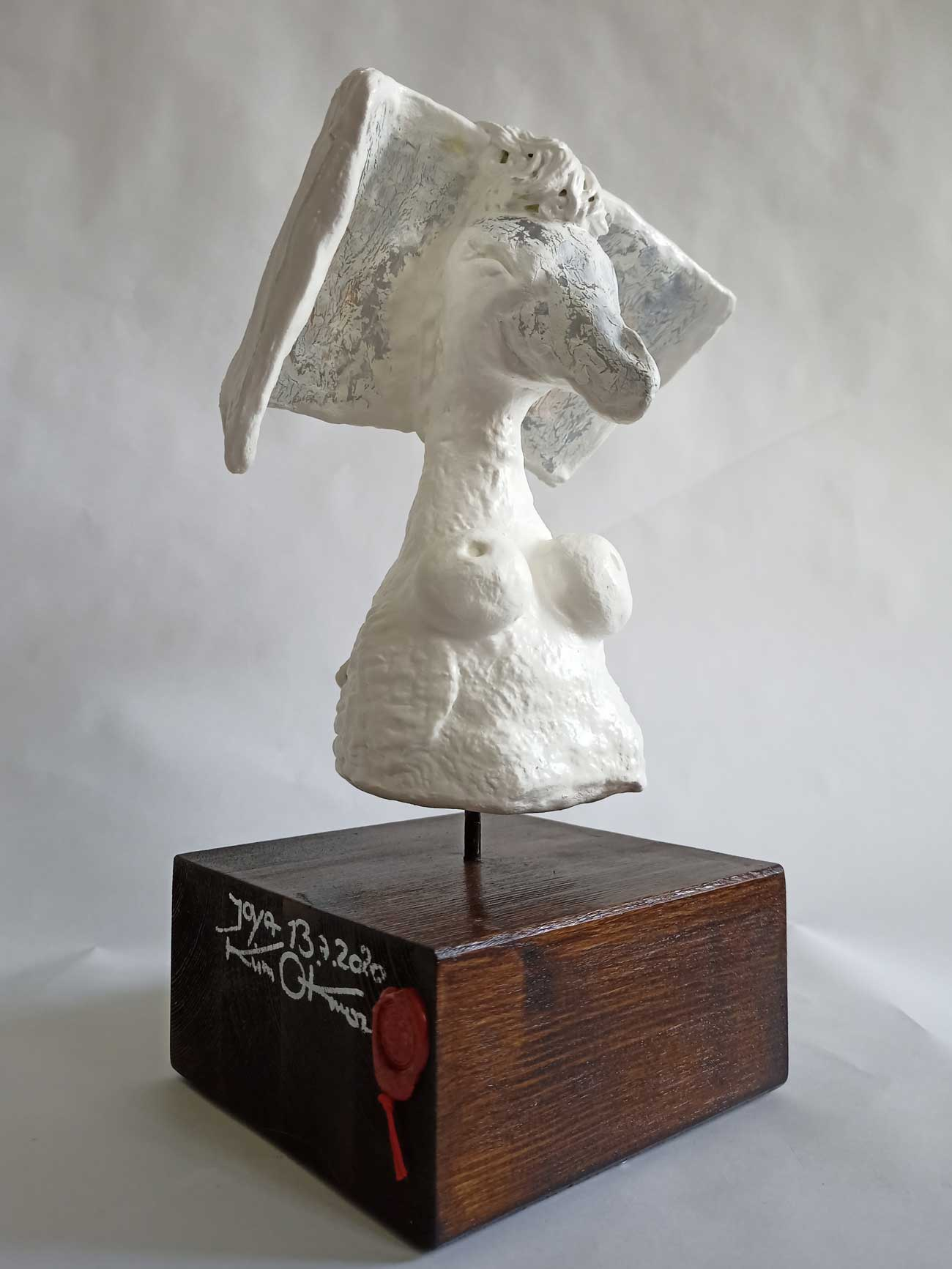 Joya neosacral sculpture on wooden base